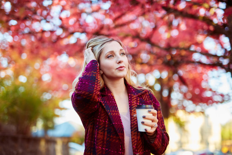 Autumn Beautiful Woman Beauty In Nature Casual Clothing Day Focus On Foreground Front View Leisure Activity Lifestyles Nature One Person One Young Woman Only Outdoors Park - Man Made Space Real People Red Standing Tree Young Adult Young Women