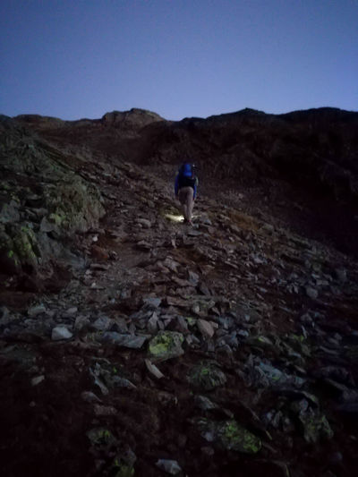 Best hikes start early! Hiking Nightphotography Travel Adventure Beauty In Nature Clear Sky Day Early Morning Full Length Hiking Hikingadventures Landscape Leisure Activity Men Mountain Mountain Range Nature Night One Person Outdoors People Real People Sky Walking Women