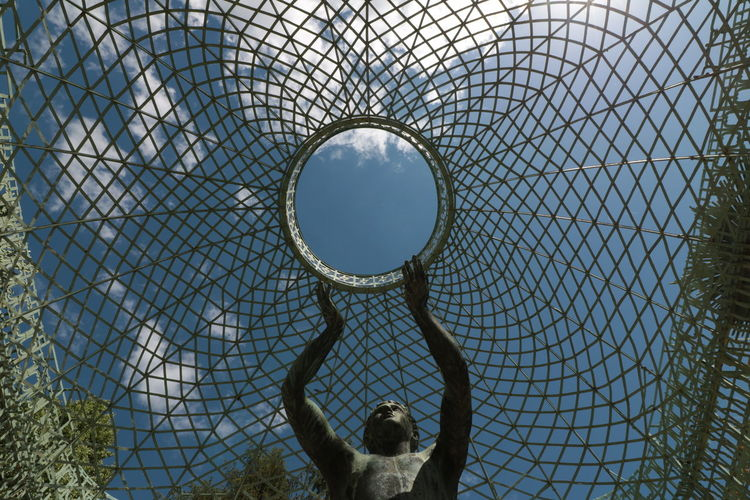 Low angle view of a sculpture against sky