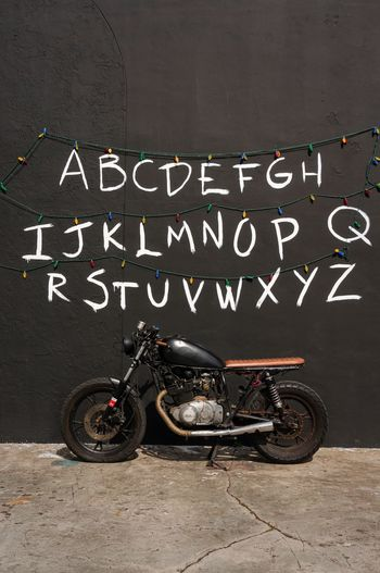 Stranger things and a motorbike • Xyz Font Characters ABC Communicate Communication Lights EyeEmNewHere AtoZ Letters Alphabet Motor Motorbike StrangerThings Stranger Things Stationary Transportation Mode Of Transport Land Vehicle Outdoors Bicycle Day EyeEmNewHere