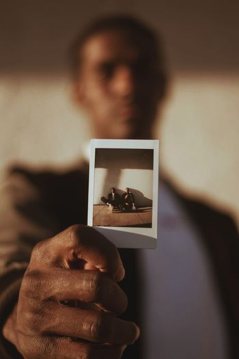 Photos Vintage Photographer Photography Photo Real People Holding Picture Frame Focus On Foreground Human Hand Indoors  Lifestyles Photography Themes Photograph One Person Men Close-up Day Young Adult People