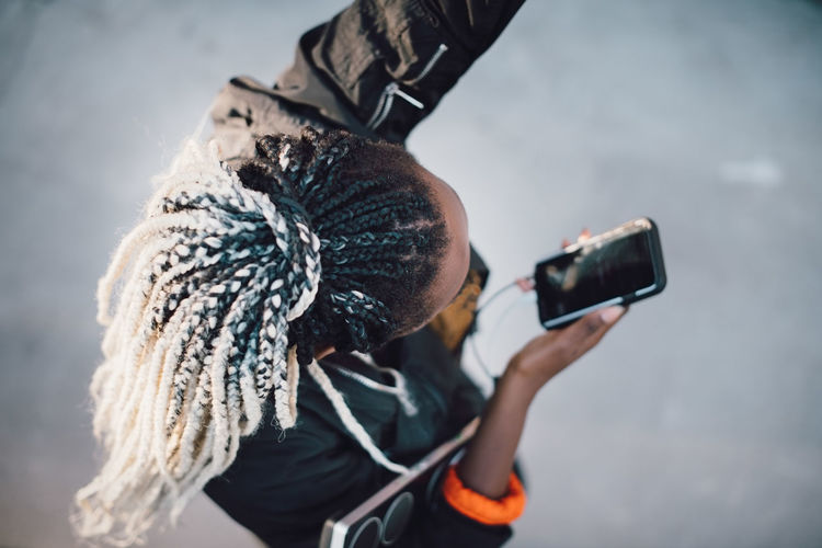 Man photographing with smart phone during winter