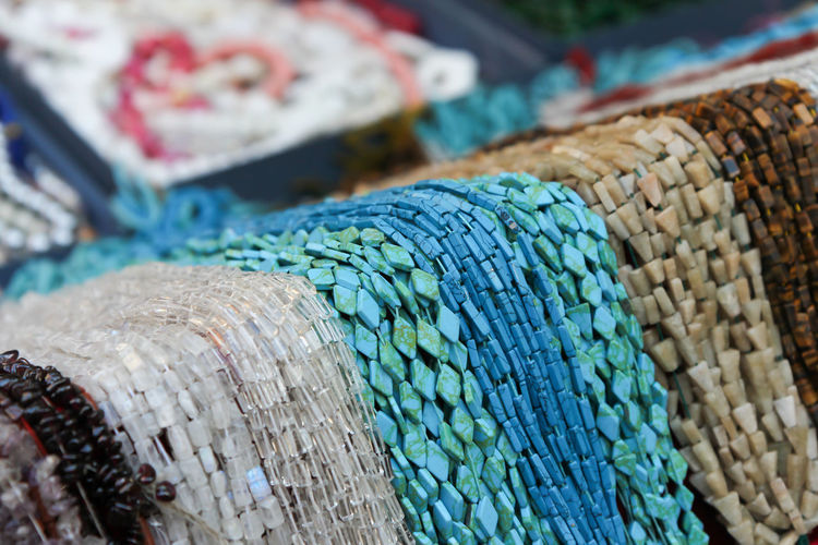 Necklace waterfall Necklaces Shapes String Blue Choice Close-up Colorful Consumerism Day For Sale Geometric Market Market Stall Multi Colored Necklace No People Outdoors Pattern Retail  Selective Focus Still Life Textile Textured  Variation Waterfall