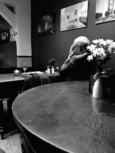 Indoors  Table Day Man Men Lonely Loneliness Loneliness And Sadness Sad Sadness Disappointed Disappointment Alone Alone Time Restaurant Flowers Table Tables Left Leftovers One Person Tired Tired! Life Lifestyles