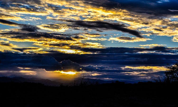 Atardeceder en desierto de la tatacoa. Back Lit Beauty In Nature Cloud Cloud - Sky Cloudscape Cloudy Dark Dramatic Sky Idyllic Landscape Majestic Moody Sky Nature No People Orange Color Outdoors Outline Scenics Silhouette Sky Sun Sunbeam Sunset Tranquil Scene Tranquility