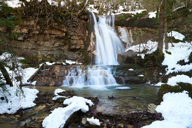 Snowy Waterfall EyeEm Best Shots EyeEm Nature Lover Ice Long Exposure Shot Nature Nature Photography Beauty In Nature Day Environment Long Exposure Nature Naturelovers No People Outdoors River Scenics Snow Travel Destinations Tree Water Waterfall Waterfront