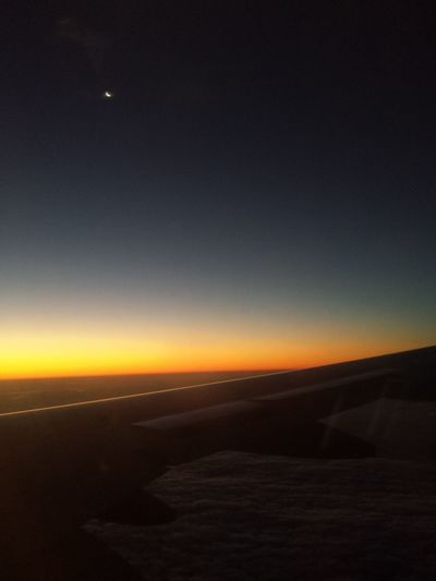 In-flight sunrise meets the moon. Inflight Sunrise Dawn Dawn Of A New Day Night Moon Astronomy Scenics Landscape Outdoors Beauty In Nature Nature Tranquility No People Sky Space Star - Space Constellation Clear Sky Airplane Airplane Wing