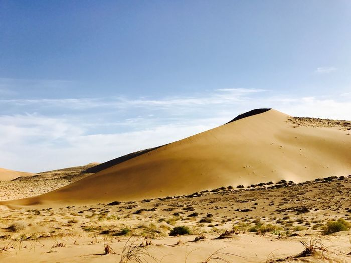 MagnificentGold Sand Dune Sand Desert Nature Landscape Sky Tranquil Scene Scenics Arid Climate Non-urban Scene Day Tranquility Beauty In Nature Outdoors Sunlight Cloud - Sky Physical Geography No People Desert Badainjaran Adventure Done That. Lost In The Landscape The Great Outdoors - 2018 EyeEm Awards