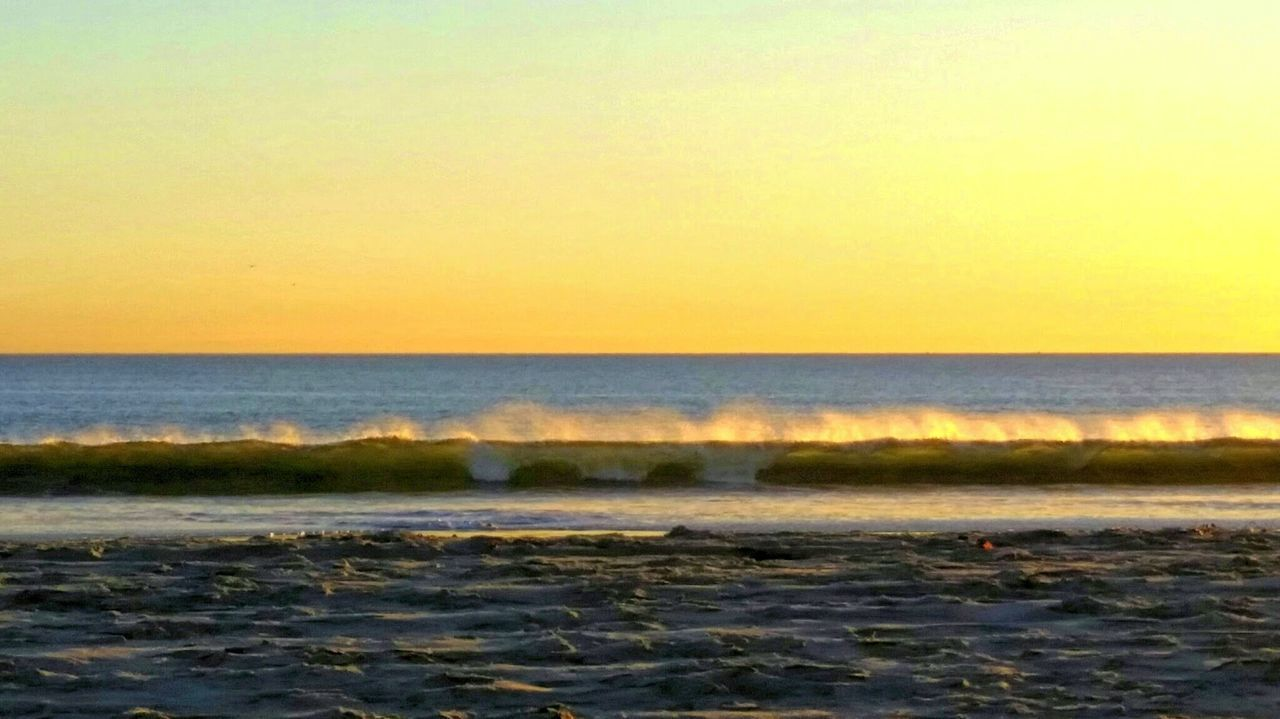 sea, sunset, water, nature, beauty in nature, scenics, beach, wave, horizon over water, no people, tranquility, tranquil scene, outdoors, sky, clear sky, scenery, day