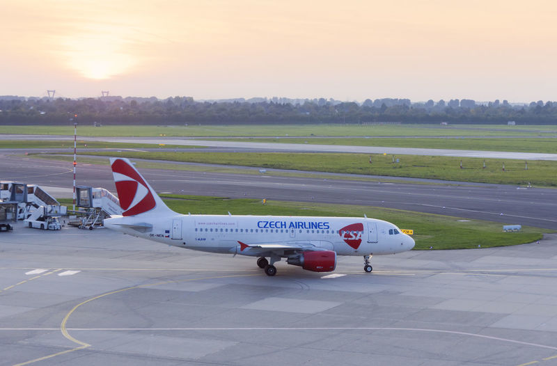 Airbus A319 of Czech Airlines rolling to runway AirPlane ✈ Airbus Airbus A319 Czech Czech Airlines Czech Republic Driving Plane Runway Transportation A319 Air Vehicle Airfield Airplane Airport Airport Runway Commercial Airplane Full Length High Angle View Rolling Runway Side View Sunset Transportation Travel