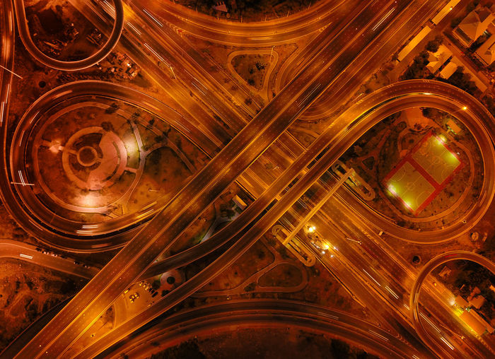 Directly above shot of intertwined highways at night