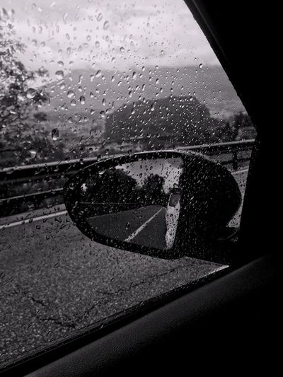 Glass - Material Window Vehicle Interior Car Car Interior Land Vehicle Transportation Wet Mode Of Transport Drop Rain Water Windshield Side-view Mirror Looking Through Window Vehicle Mirror No People Close-up Indoors  Photo Black And White Friday