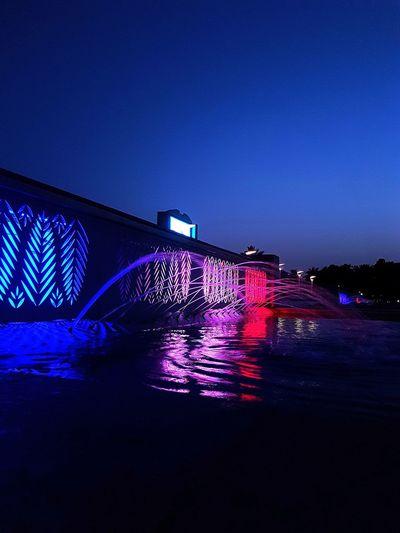 fountain, lagoon water park, night vision, dancing liight. Illuminated Blue Sea Architecture