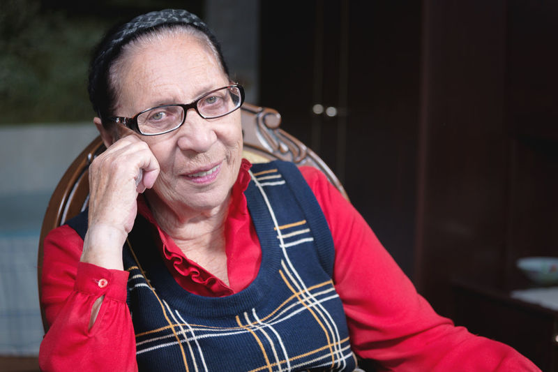 Senior woman with eyeglasses sitting at home