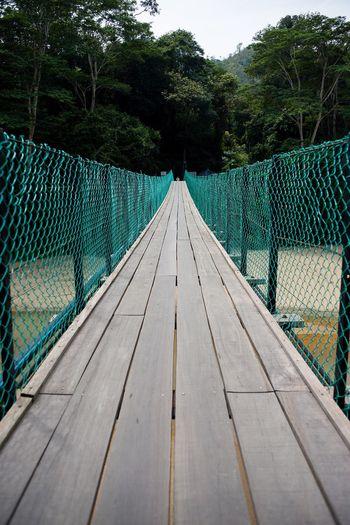 Empty footbridge over river