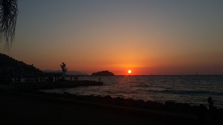 Sunset Water Scenics Sun Sea Tranquil Scene Silhouette Tranquility Beauty In Nature Horizon Over Water Beach Idyllic Orange Color Nature Shore Mountain Majestic Sky Outdoors Remote Vacations Holiday Journey Kusadasi, Turkey OpenEdit