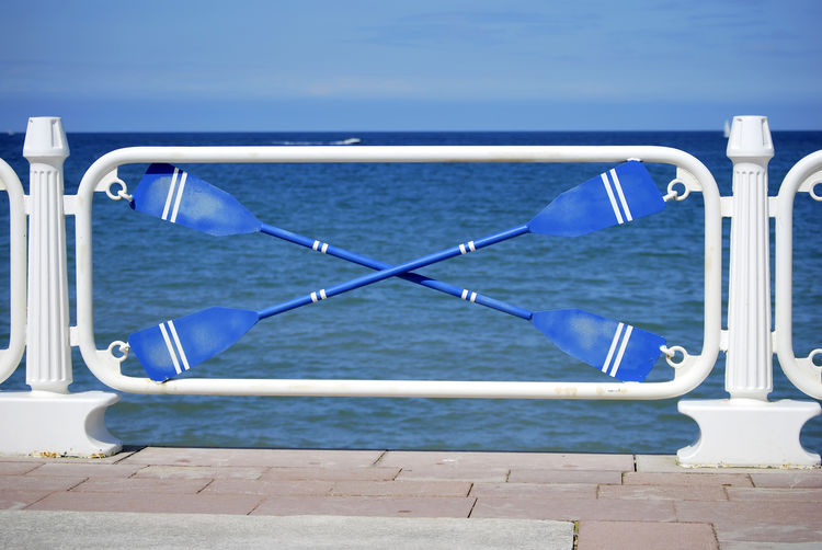 Oar Rowing Absence Beauty In Nature Blue Day Fence Horizon Horizon Over Water Metal Nature Nautical Vessel No People Outdoors Railing Rower Scenics - Nature Sea Sky Sunlight Tranquility Water