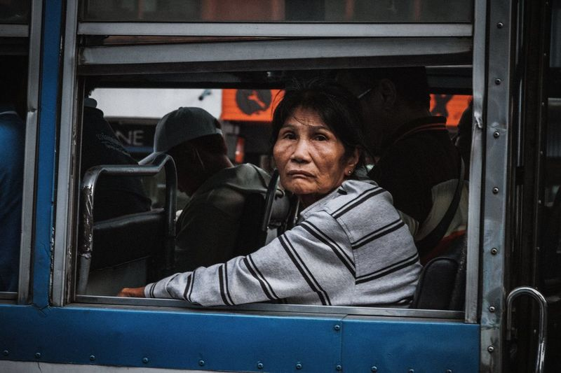 Portrait of mature woman sitting in bus