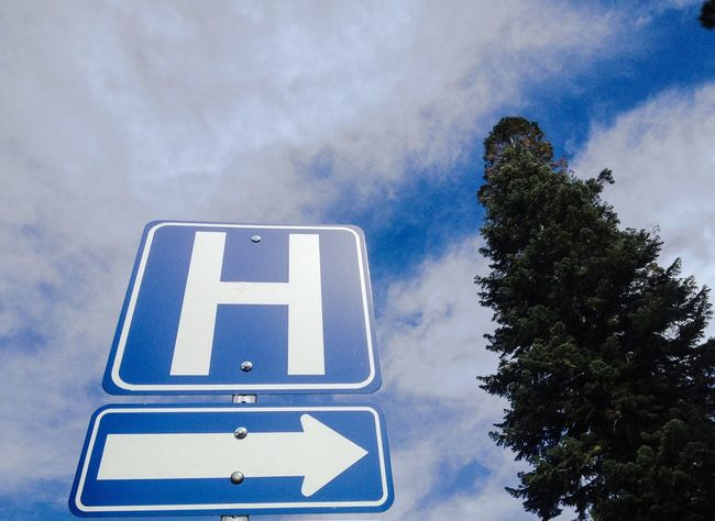 Sign for the hospital. Hospital Sign Hospital Signs Sign Direction Road Sign Communication Directional Sign