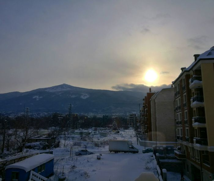 Room view, where urban meets nature Snow Winter Cold Temperature Mountain No People Nature Outdoors Beauty In Nature Overcast Window View Landskape Scenery Buildings & Sky Sunshine Lensflare