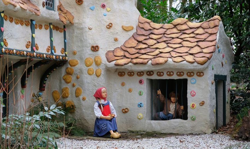 Attraction theme park the Efteling, Kaatsheuvel, the Netherlands. Architecture Built Structure Building Exterior Day Building Full Length Real People House One Person Women Plant Clothing Outdoors Nature Childhood Tree Standing Child Adult