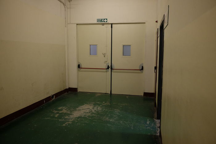 corridor with anti-panic doors Doors Emergency Panic Security Anti-panic Concept Corridor Emergency Exit Empty Escape Evacuation Interior Metal No People Push Safety Secure Symbol