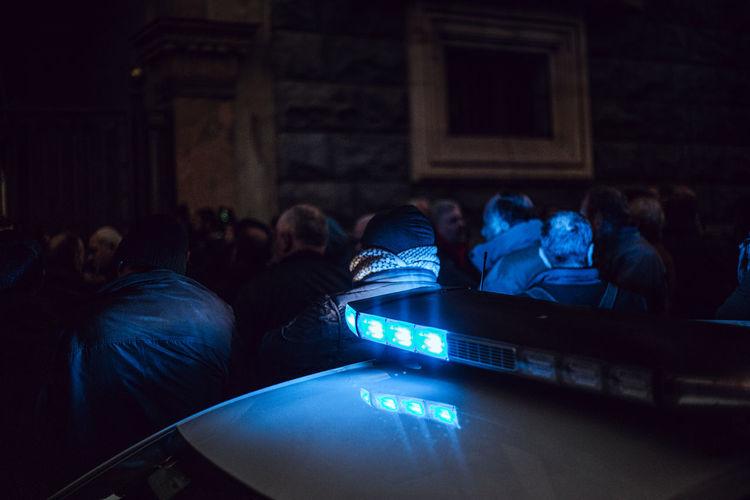 Illuminated siren on police car at night