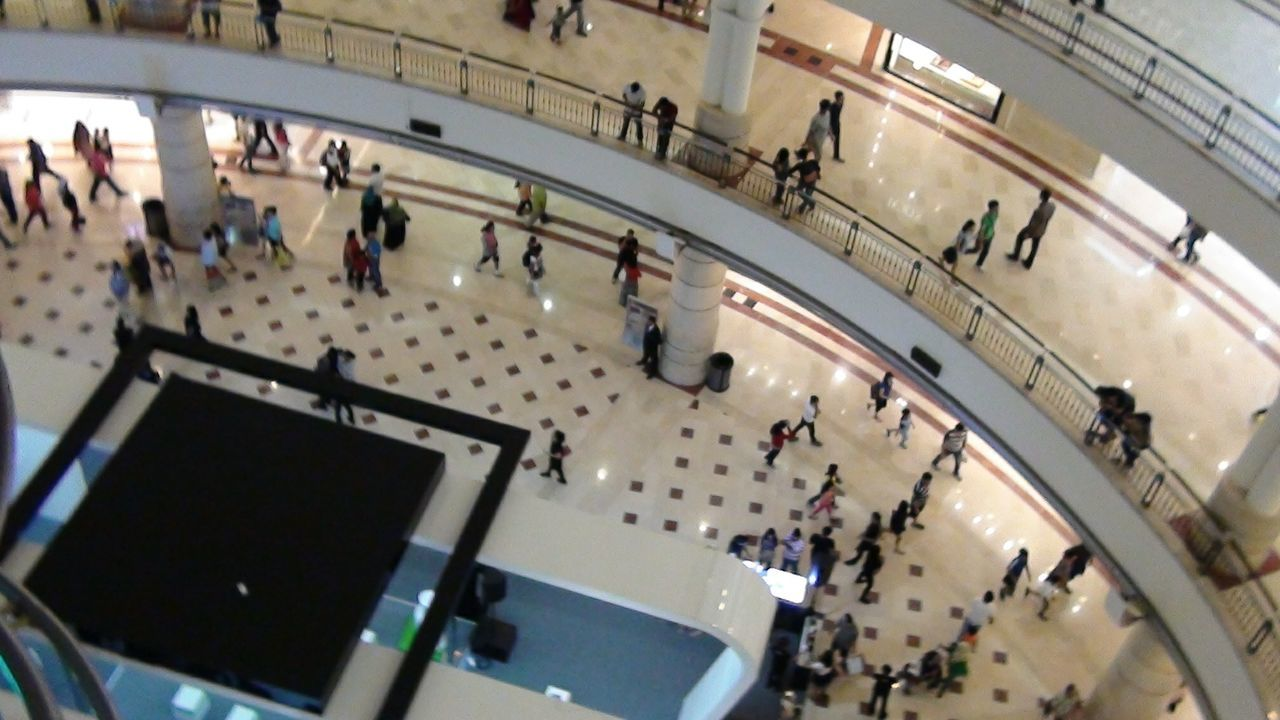 large group of people, high angle view, real people, indoors, lifestyles, walking, women, architecture, steps and staircases, crowd, built structure, mixed age range, men, leisure activity, day, modern, people, adult