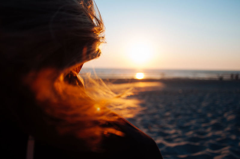 Portrait of woman on beach during sunset
