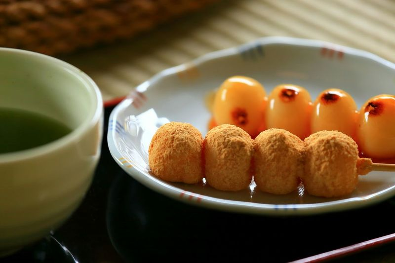 Close-up of glazed on mitarashi dango with sauce