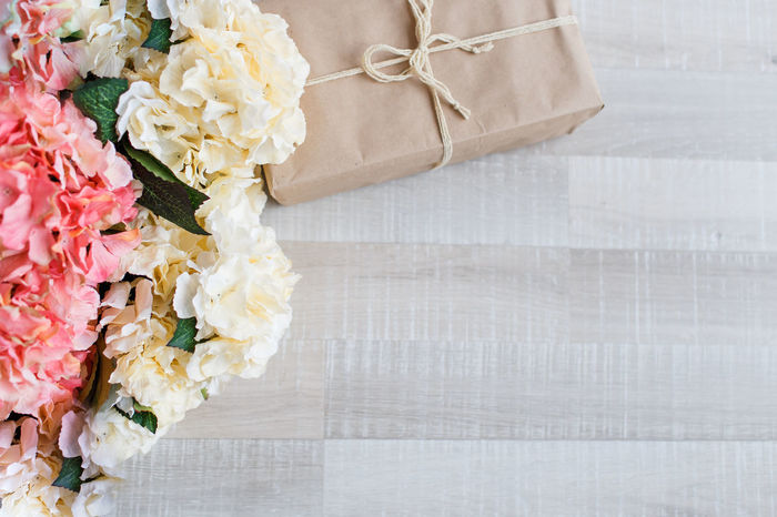 hydrangea flowers and present gift on wooden background. Holiday background. Mother's day background Background Bouquet Box Celebration Celebration Congratulations Day Decoration Flower Gift Gifts Mother's Day No People Present Presents Star Texture