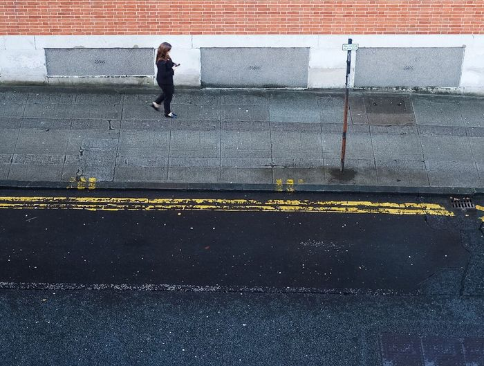 Full Length Outdoors One Person Road Asphalt Day Person Adult People Streetphotography Street Photography Red Brick Building City City Centre