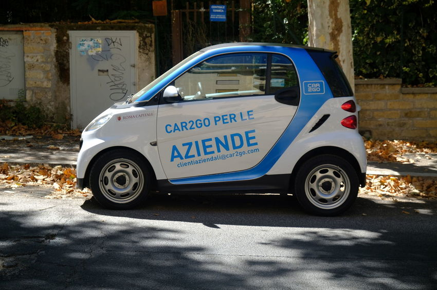Rome, Italy - August 13, 2017: parked Car2Go Smart car. Car2Go is a subsidiary of Daimler AG providing car-sharing services in European and North American cities CAR2GO Smart Car Car Sharing Cartogo Land Vehicle Mode Of Transport No People Outdoors Smart Car Smart Cars Transportation