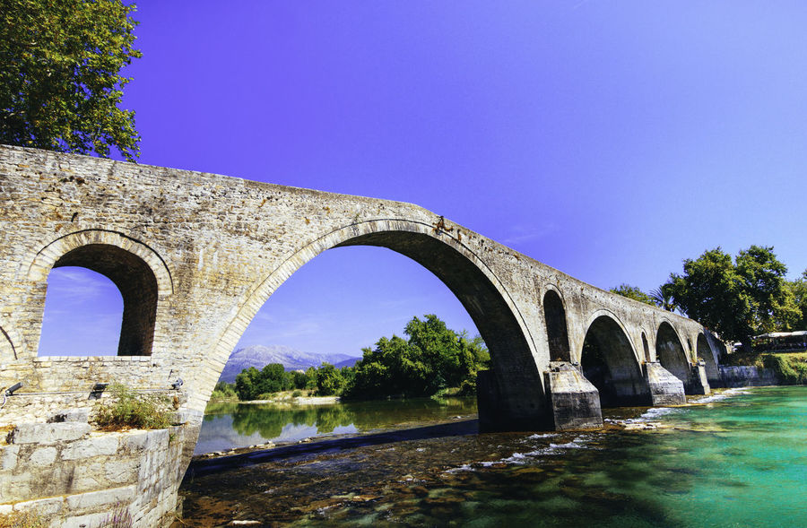 Bridge of Arta EyeEm Best Shots EyeEm Nature Lover EyeEmNewHere Sky And Clouds Arch Architecture Blue Bridge - Man Made Structure Built Structure Clear Sky Connection Day Eye4photography  Greece Low Angle View Nature No People Outdoors Photography Photooftheday River Sky Tree Water