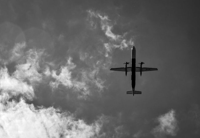 Cloud Fly Air Vehicle Airplane Airport Airshow Beauty In Nature Blackandwhite Cloud - Sky Clouds And Sky Day Flying Journey Light And Shadow Low Angle View Mode Of Transport No People Outdoors Sky Transportation Travel