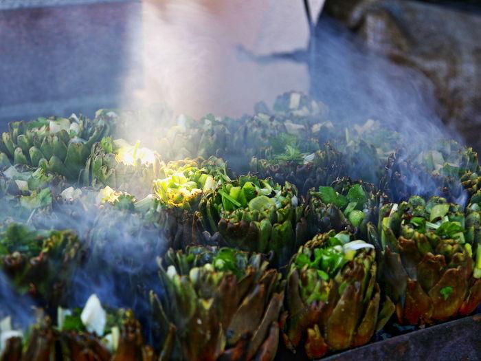 Close-up of artichokes with smoke