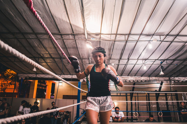 Concentration. International Women's Day 2019 Real People Young Adult One Person Young Women Adult Lifestyles Leisure Activity Front View Clothing Hairstyle Low Angle View Women Muay Thai Kickboxing Sportswoman Sport
