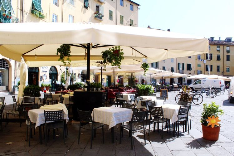 Lucca Italy Lucca Italy Seat Chair Architecture Built Structure Building Exterior Table Restaurant Cafe Building Potted Plant Setting Place Setting Day City Sidewalk Cafe