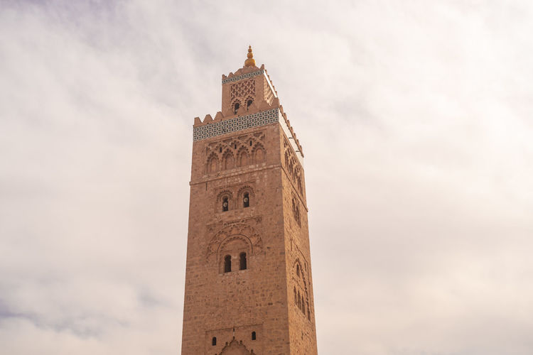 Low angle view of clock tower against sky