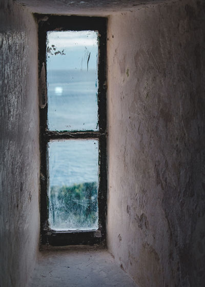The view from one of the lighthouse windows. Historical Building Shade Travel Architecture Blue Building Building Exterior Built Structure Day Dirty Explore Frame Historic Indoors  Moody Nature No People Old Shadow Sky Stained Urban Urbex Water Window Visual Creativity The Still Life Photographer - 2018 EyeEm Awards A New Perspective On Life Capture Tomorrow Springtime Decadence