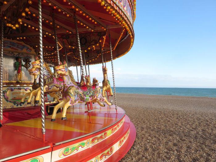 Carousel At Beach Against Clear Sky