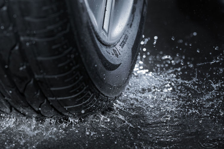 Close-up of water splashing by tire