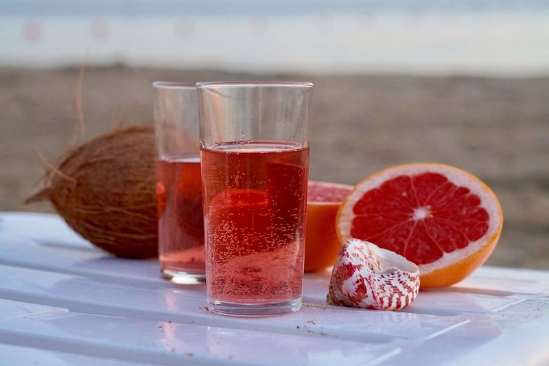 Close-up of juice and glass on table