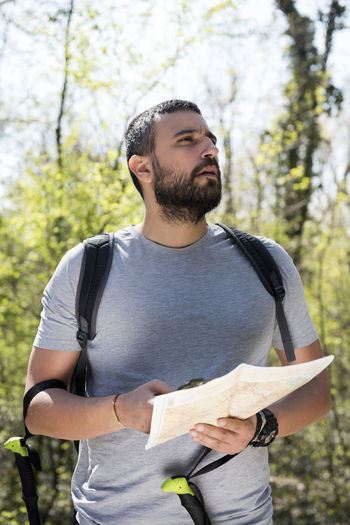 Forest path summer time Nature Mountain Hiking Young Map Compass Lifestyle Activity Freedom Adventure Backpack Man Summer Day Adult Caucasian Healthy Sunny Recreation  Male Outdoors View Vacation Environment Leisure Hike Beautiful Attractive Travel Equipment Sport Forest Lost