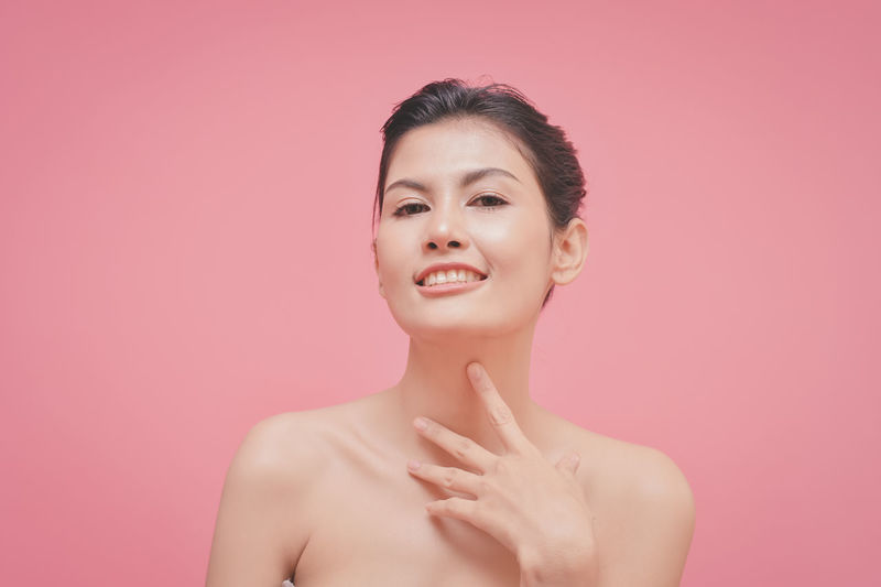Adult Beautiful Woman Beauty Colored Background Contemplation Front View Hairstyle Headshot Human Body Part Human Face Indoors  Looking One Person Pink Color Portrait Shirtless Smiling Studio Shot Women Young Adult Young Women