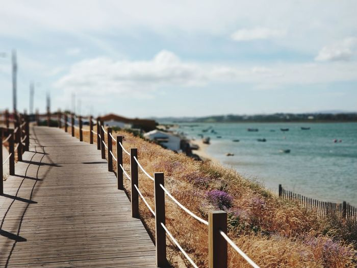 Water Sea Beach Sand Railing Sky Horizon Over Water Footbridge Wooden Post