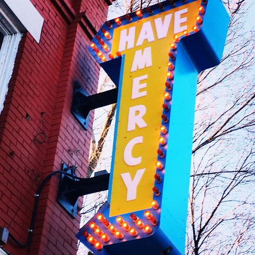 Next door to Holy Rollers. Have Mercy Mercy  Streetphotography Yeg Whyte Ave Edmonton Urbanphotography Urban Signs Architecture Communication Text Low Angle View Architecture Guidance Outdoors Built Structure Illuminated Building Exterior No People