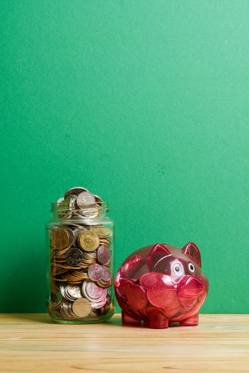 Piggy bank . Saving concept Green Piggy Bank Red Conceptual Photography  Future Investment Isolated White Background Saving Money