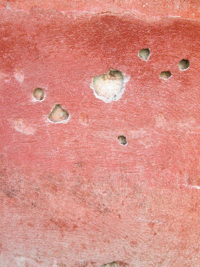 Full Frame Shot of Red Cracked Plastered Wall 2016 ArchiTexture Backgrounds Concrete Wall Cracked Wall Day Holes Mould Old Plaster Red Scratched And Cracked Wall Stain Textures And Surfaces Weathered Wall