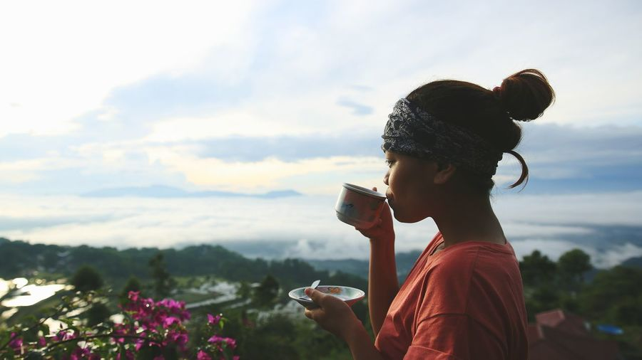 Close-Up Of Woman Drinking Coffee Outdoors
